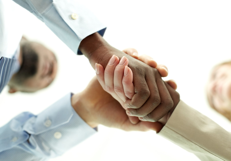 Close-up of shaking hands of two businesspeople