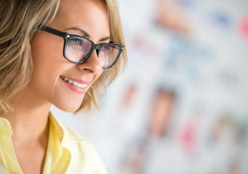 Portrait of a business woman wearing glasses and looking like a hipster
